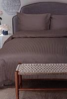 Комплект постельного двухспального белья коричневого цвета.