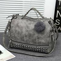 Женская вместительная сумка Mei&Ge с заклепками и меховым брелком серая