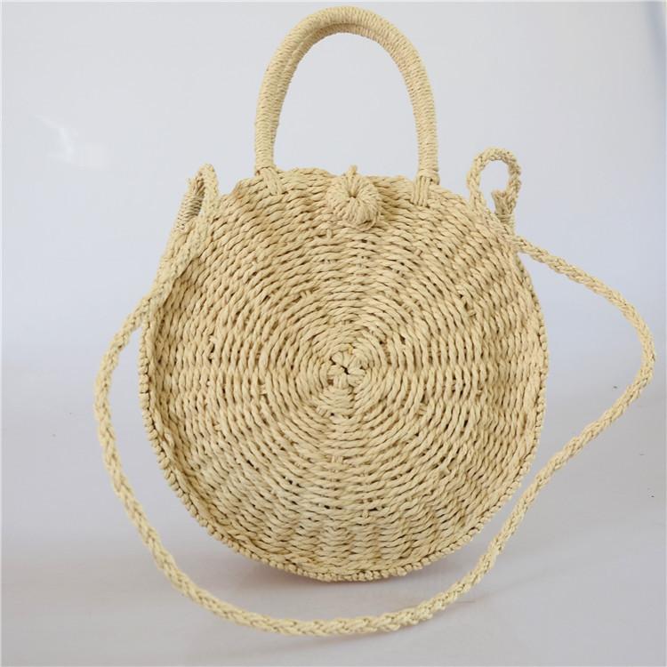 Женская круглая плетеная сумочка с ручками бежевого цвета, фото 1