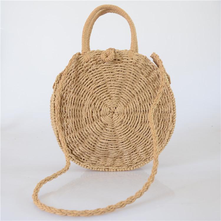 Женская круглая плетеная сумочка с ручками коричневого цвета, фото 1