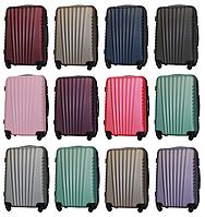 Средние пластиковые чемоданы Fly 8844