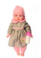 Пупс игрушечный в зеленой одежде с бутылочкой M 3887 UA LIMO TOY мягконабивной, музыкально-звуковой   куколка