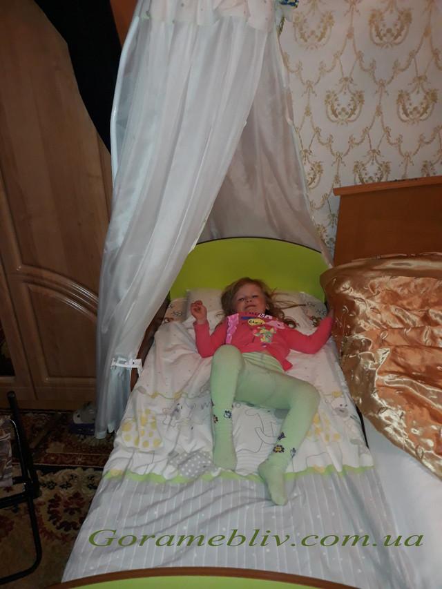 """На фото: кровать """"Детская Новая"""" с девочкой (фото наших покупателей)"""