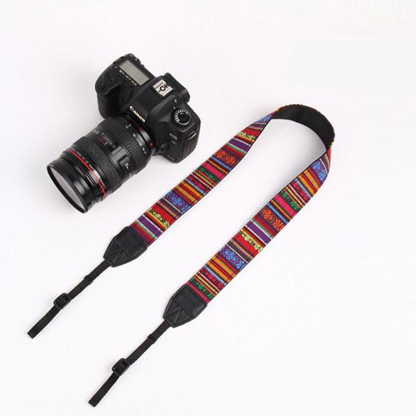 Универсальный ремень для фотокамеры.