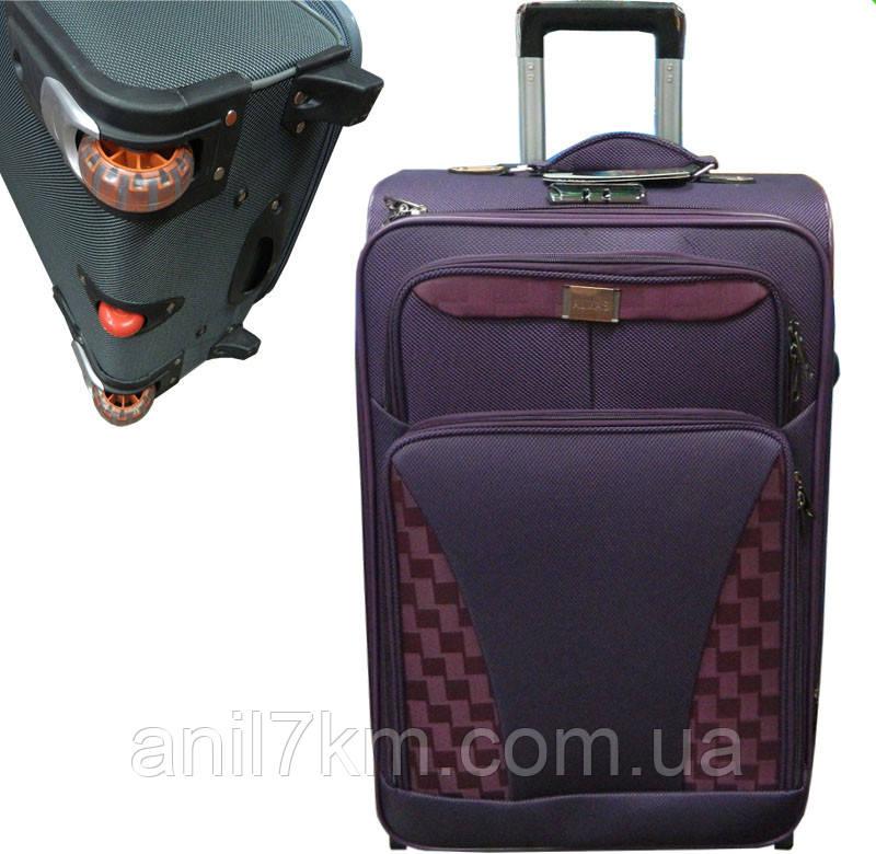 Великий дорожній чемодан на трьох колесах
