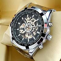 Механические мужские наручные часы скелетоны Winner TM 340 Skeleton серебряного цвета с автоподзаводом