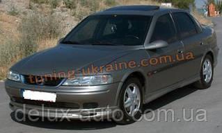 Юбка на передний бампер под покраску на Opel Vectra B 1995-2002
