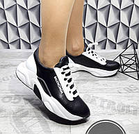 Женские кожаные кроссовки черного цвета