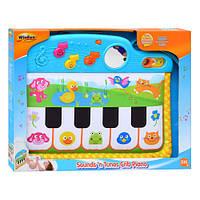 Детское пианино Win Fun 0217 NL крепиться к кроватке