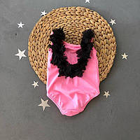 Суцільний рожевий купальник для дівчинки