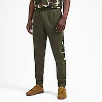Штаны спортивные Puma  мужские Rebel CAMO Pants cl FL