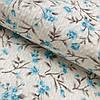Ткань скатертная жаккардовая с голубыми цветочками на молочном фоне, ширина 150 см