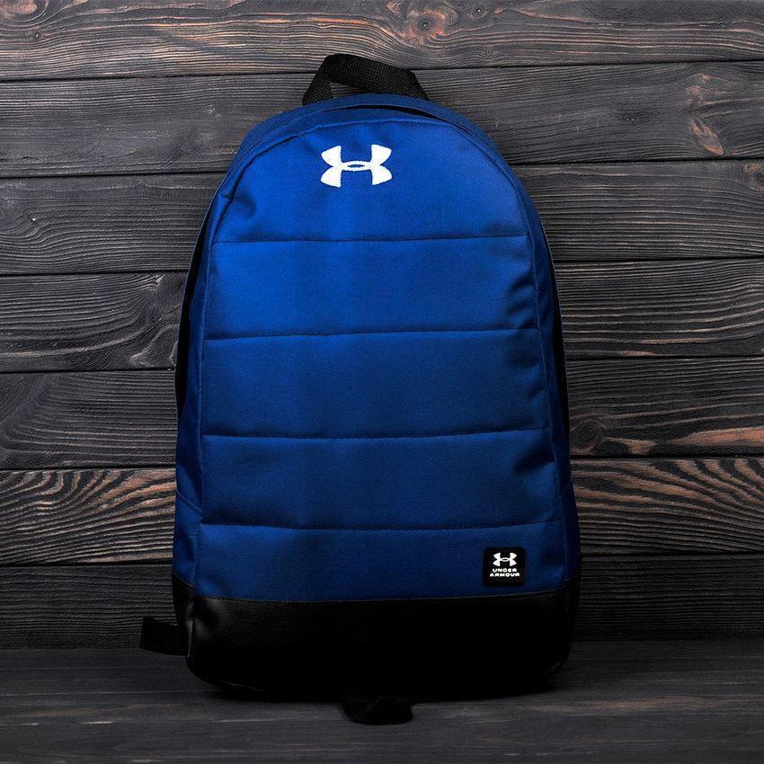 Стильный рюкзак Under Armour, андер темно-синего цвета с вставками кож зама черного цвета.