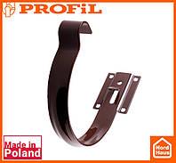 Водосточная пластиковая система PROFIL 90/75 (ПРОФИЛ ВОДОСТОК). Держатель желоба малый метал 90, коричневый