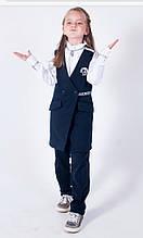 Оригинальный черный школьный костюм на девочку - жилетка и брюки с карманами.
