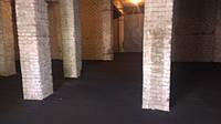 Укладка асфальтового покрытия на бетонное основание в ангаре