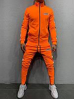 Спортивный костюм мужской оранжевый с лампасами и молниями внизу брюк