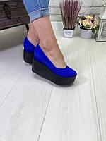 Модные туфли на устойчивой платформе.