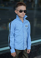 Детская рубашка на мальчика с эмблемой и лентами на рукавах