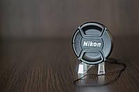 Крышка на объектив с надписью Nikon 55mm