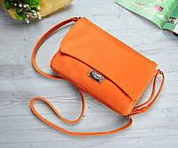 Маленькая оранжевая сумочка
