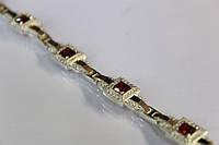 Серебряный браслет с красными камнями с золотыми вставками 17 г. серебро 925 золото 375