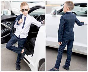 Школьный костюм-двойка классика в крупную клетку на мальчика.