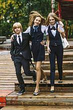 Дитячий одяг: шкільна форма, спортивний одяг для діток, повсякденний та святковий одяг.