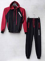 Спортивний костюм для хлопчика на 8-11 років сірого, синього, чорного кольору із капюшоном Reebok оптом