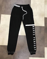 Спортивные штаны женские карманы манжеты текст S-L (деми)