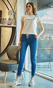 Женские джинсы с модным подворотом