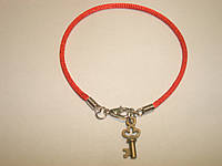 Красная нить с талисманом «Ключ желания»