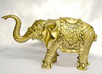 Слон с поднятым хоботом - символ богатства,стабильности,устойчивости.