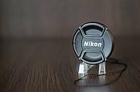 Крышка на объектив с надписью Nikon 77mm