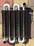 2.55.35.00000 Теплообменник первичный TeploWest АГД 18-С-М 180 х 190 мм, фото 2