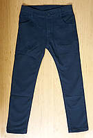 Котоновые темно-синие зауженные брюки для мальчика