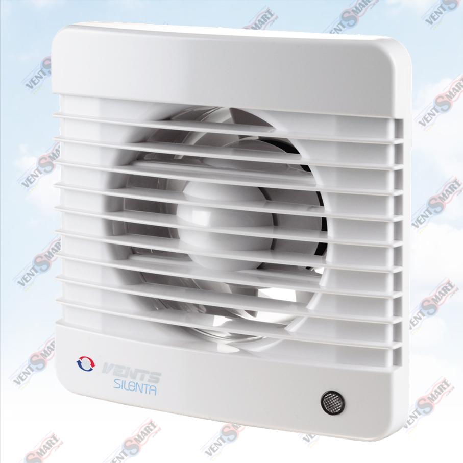 Внешний вид (фото, изображение) вентилятора для ванной Вентс Силента-М 100/125/150 белого цвета. Вентилятор обладает привлекаельным и современным дязайном, имеет малое энергопотребление, высокую продуктивность и низкий уровень шума. Модификации Вентс Силента-М: со шнурком, с реле времени, с реле влажности, датчиком движения.
