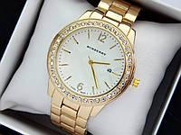 Burberry -  женские наручные часы золотого цвета с белым циферблатом