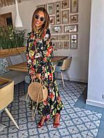 Красивое женское длинное платье с цветочным принтом