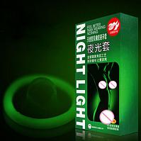 Неоновые презервативы, светящиеся в темноте