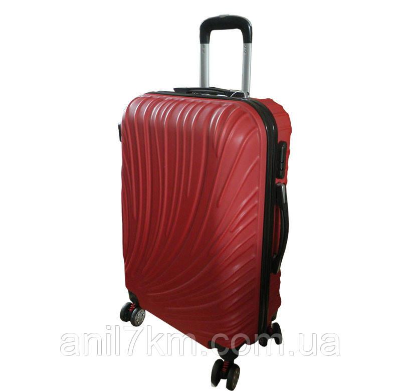 Средний чемодан на четырёх колёсах с амортизаторами