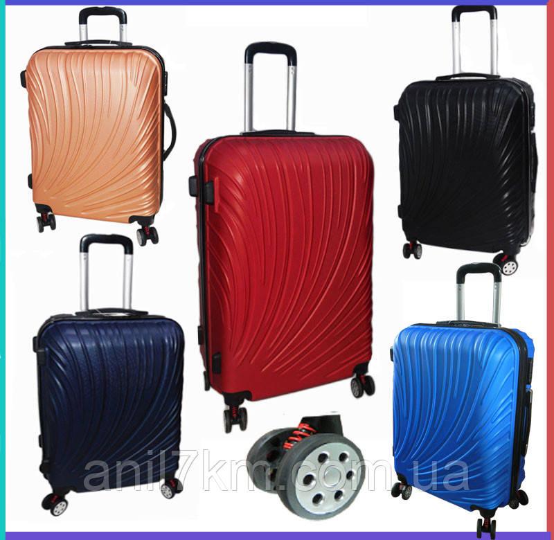 Середній валізу на чотирьох колесах з амортизаторами