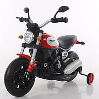 Детский электромобиль мотоцикл красный колеса надувные от 3-х до 8-ми мотор 2*15W аккумулятор 6V7AH