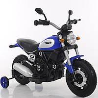 Детский электромобиль мотоцикл синий колеса надувные от 3-х до 8-ми мотор 2*15W аккумулятор 6V7AH