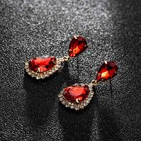 Сережки з камінням red gold