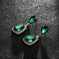 Сережки з камінням green gold