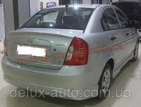 Юбка на задний бампер под покраску на Hyundai Accent 2006-2011