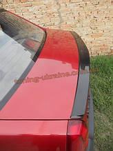 Спойлер-сабля из стеклопластика на Dacia Logan 2004