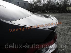 Спойлер-сабля из стеклопластика на Kia Rio 3 2011-2015 седан
