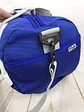 Небольшая красивая спортивная сумка бочонок Fila., фото 4